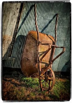 """""""My grandfather's old wheelbarrow leans against the wall of the grainery in our barnyard"""". - a third view"""