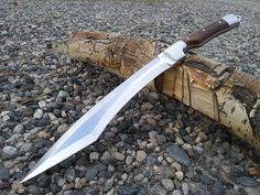 Kukri Machete Is a one off design of my own. The blade is 9.5'' long, 15'' overall and is 3/16 thick, made of 01 tool steel chainsaw bar. All stainless steel bolsters and ballistic Micarta. It comes with a Kydex sheath. Free Shipping!