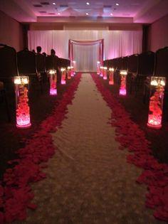 I like the idea of the rose petals lining the isle.