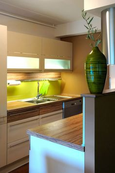And another idea for a small kitchen. White combined nicely with the wood.