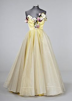 Madame Grès ball gown, mid 1950s,  the dress formed from four layers of white and yellow chiffon, organza and taffeta and a final translucent overlay of glistening white horsehair which gives glimpses of the primrose yellow layers below and also ensures a perfect silhouette