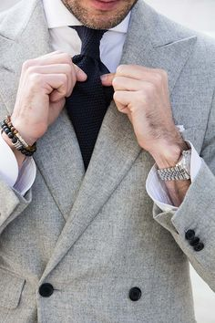 silver accessories are the perfect additional to neutral tones | Al Bazar double breasted blazer | He Spoke Style