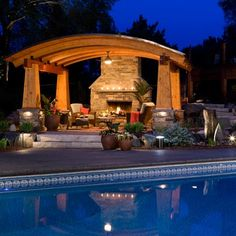 Arched pergola with fireplace, amazing.