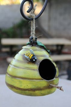 Ceramic Birdhouse or bird feeder.  A quirky little yellow bee hive on Etsy, $30.00