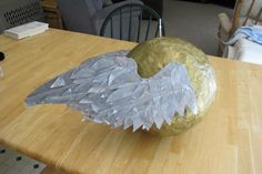 "Homemade golden snitch pinata. Says ""I open at the close"" across the front."
