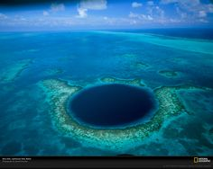The Great blue hole, Belize is positioned immediately at a distance of 60 miles off the coastline of Belize; it is a submerged sinkhole that the majority of the researchers think is the biggest of its sort. More At:great blue hole belize Belize City, Places To Travel, Places To See, Travel Destinations, Holiday Destinations, Great Blue Hole, Big Blue Hole, Magic Places, To Infinity And Beyond