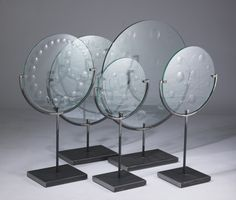 facetted glass disks on metal stands