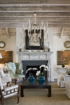 Limed wood ceiling sets the tone. Love the symmetry of the fireplace wall and comfortable seating arrangement.