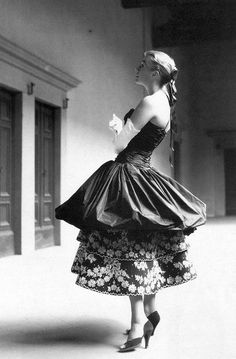 Model in a ruched taffeta evening dress by Emilio Schuberth, photo by G.M. Fadigati, 1955
