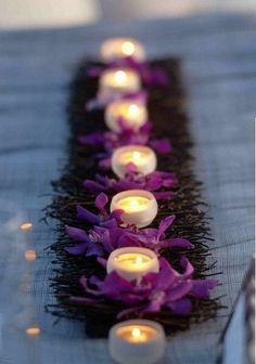 Orchids on moss: centerpiece with tea light candles. Simple and pretty!