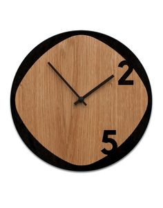 Clock25 - Wood & Black Sabrina Fossi designs 'Clock25', a wooden wall clock consisting of two overlapping laser cut surfaces. A simple silhouette made from a natural material: wood. Produced with a combination of advanced robotic manufacturing and hand-crafted techniques, the clock is available in natural oak and MDF or all-MDF.