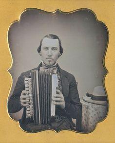 Musician with his accordion (via Dennis A. Waters Fine Daguerreotypes)