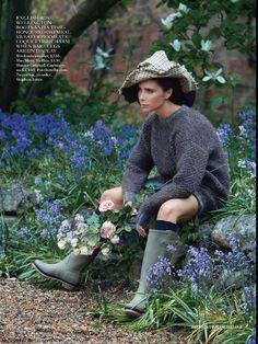 Victoria Beckham wearing Hunter rain boots for Vogue UK August 2014