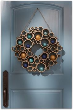 Isn't this wreath adorable? It's created using PVC pipe and ornaments. Happy Holidays, Victoria Christian