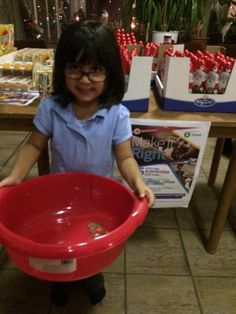 Sofia from Reception helps collect money for Kramare at the Music Department Winter Concert. Over 600 euros raised!