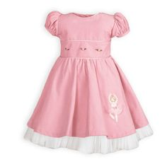 Pink cotton pinwale corduroy with pink satin trim. Ribbon rosebuds accent waistline. Ballerina appliqué decorates skirt. Attached slip with tul