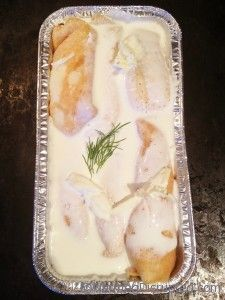 Nalysnyky ~ Ukrainian crepes filled with dry cottage cheese & dill and baked with whipping cream and butter.  Sounds so good.