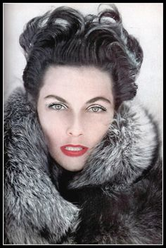 Unidentified model wearing silver fox coat, Harper's Bazaar, October 1953