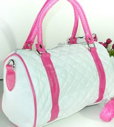 Item Type: Handbags Exterior: Hello Kitty Number of Handles/Straps: Single Interior: Interior Compartment Closure Type: Zipper Handbags Type: Shoulder Bags Shape: Barrel-shaped Decoration: Embroidery