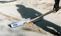 Pavetech Sandpull -  helps make the sand screeding process faster and easier. One side is used to pull back excess sand to where it will be needed next during the screeding process. The other rounded side is used for filling in screed pipe marks and for touch-up after the dog or the home owner walks across your project. After removing your screed pipes, add some sand to the void and pull the SANDPULL across the top. It will ride on the screeded sand and screed off your filled void.