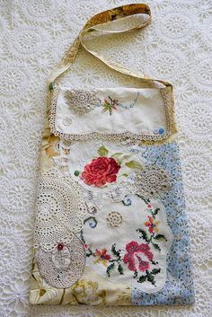Its a field of flowers! This boho bag is adorned with embroidery patches, doilies, buttons, flowers and cross stitch. Made from soft cotton, doilies,