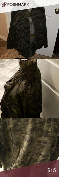 Camo jacket. This is a camofouge jacket with a zipper n buttons to close the front. Four pockets in the front with a drawstring to sinch the waist. It also has a zipper around the collar for a hood but hood was cut out when I bought it. a.n.a Jackets & Coats Utility Jackets
