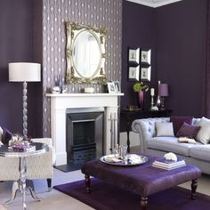 Darkest of purple gives the finest finishing on the walls here. A light grey sofa paired with grey and purple cushions plus a white lamp and small purple table, what more can one ask for creating that rich look in the living room.