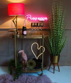 10 Of The Best Drinks Trolleys & Cabinets To Get Your Party Started - The Interior Editor Bar Cart Styling, Bar Cart Decor, Coin Photo, Metal Bar Cart, Gold Bar Cart, Deco Rose, Vintage Stil, Home Trends, Neon Lighting
