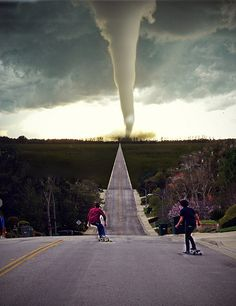 Kids skateboard towards tornado