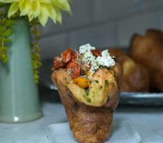 parmesan popover topped with blistered tomatoes and herbed goat cheese