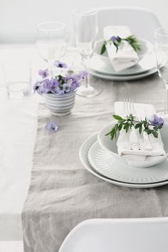 pure table setting with purple flower accents