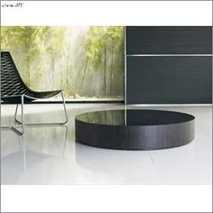 Modern Round Coffee Table with glass top.