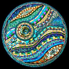 http://www.jrmosaics.com/images/rotating-jeweled-circles/rotating-jeweled-circles4detail.jpg