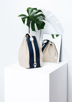 Planting the notion of a new spring bag.