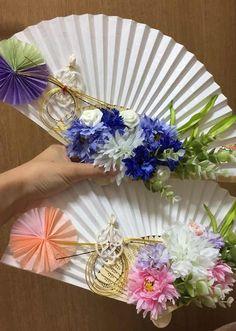 水引やお花やペーパーファンをつけた扇子プロップス