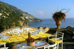 Drinking Sunset Cocktails on the Terrace of the Hotel San Pietro    One of the more indulgent highlights of an Amalfi Coast tour. The celebrated Hotel San Pietro enjoys a setting second to none, clinging to the side of a cliff just east of Positano. Cocktails are served on the top terrace to a backdrop of the town's twinkling lights. Magic.    Photo Caption: Hotel San Pietro in Positano, Italy.    Photo by dianitam/Flickr.com