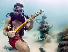 Divers strum on marine-themed musical instruments at the Lower Keys Underwater Music Festival in the Florida Keys National Marine Sanctuary off Big Pine Key, Fla. Underwater Music, Big Pine Key, Beneath The Sea, Summer Events, Florida Keys, Fl Keys, Photos Of The Week, The Real World, Germany