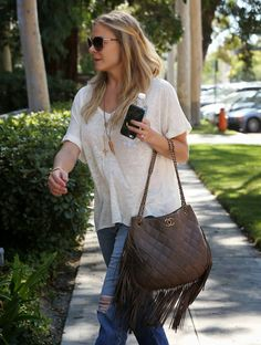 Celebrities love Chanel bags, and here are over four dozen photos to prove it. Chanel Mini, Chanel Classic Flap, Chanel Wallet, Chanel Boy Bag, Chanel Reissue, Chanel Shoulder Bag, Quilted Shoulder Bags, Best Handbags, Chanel Paris