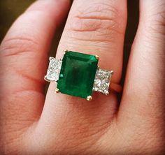 Emerald and diamond three stone.