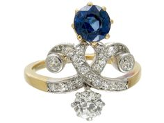 A good looking Art Nouveau ring which has been set with a strong blue sapphire and bright diamonds. It is most likely English and has an 18ct gold shank with a platinum top.