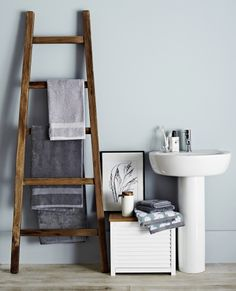 Richly toned wooden bathroom accessories bring warmth to a cool, contemporary bathroom #Expressions #JohnLewisHome