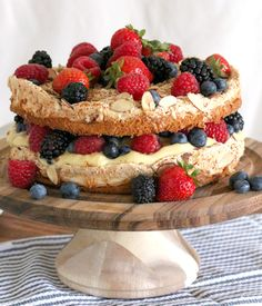 Berry Blitz Torte - A complex, rustic cake layered with rich yellow cake, fluffy meringue, sweet honey custard, toasty almonds and bright juicy berries