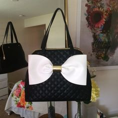 NWT Betsey Johnson bag 3 large compartment shoulder bag. Black quilted exterior adorned with a large white/bone bow and has gold hardware. I tried my best to show the different compartments by stuffing them with air pockets. Betsey Johnson Bags
