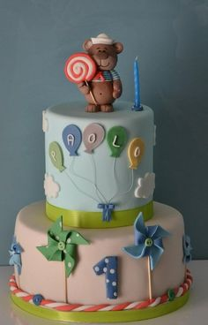 What fab cake. Pinwheels, teddy, lolly, baloons, clouds. #celebration #cake
