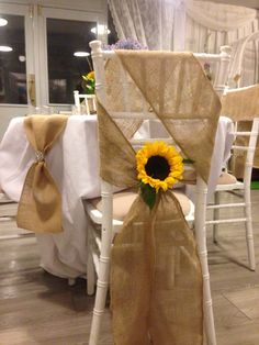 Bright sunflowers add a splash of colour to the hessian / burlap sash ❤️❤️❤️❤️❤️ If your getting married take a look at http://www.avantgardenevents.co.uk ❤️❤️❤️❤️❤️ #wedding #bride #rustic #weddingideas #bride2be #engaged #engagement #weddingdecor #decor #weddingcentrepiece #love #BrideToBe #flowers #soloverly #venuedecor #shabbyChic #inspiration #matlock #derbyshire #bakewell #chaircovers #avantgarden #centrepiece #weddinghour #weddingwednesday #venuestyling #derbyshire