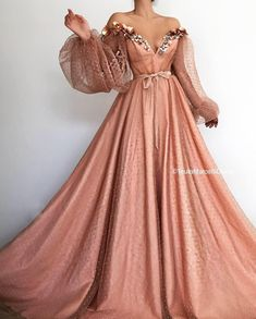 Details - Blushed Rose dress color - Organdy dress fabric - Shiny details all over the dress with glittery belt - Holographic and crystal flowers on the top - Off-shoulder dress with waist definition and long sleeves - For parties and special occasions