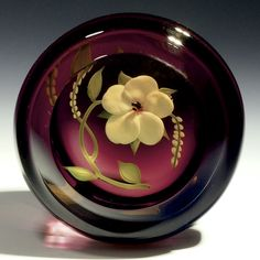 "Paul Stankard paperweight - Flower and vines in wine color. Originally made 1972. Paul personally had it recut in 2010, signed with both dates and scratch signature. 2 1/8""w x 1 1/2""t, 5.9 oz. - #0560"
