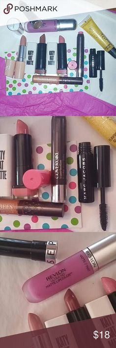 8 lip stick/glosses 1 MJ mascara/blk Various brands. Sephora burts bees, covergirl, katy... All different colors. Pretty new i just have a ton of lipsticks. As you can see they have barely been used. Sephora Makeup Lipstick