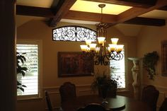 Woodforest in Montgomery Texas   This Woodforest home in Montgomery Texas chose Faux Iron in their arched dining room window. Faux Iron is great for decorating and those speciality shaped windows. It is a greats compliment to your existing iron work. Notice the chandelier color and style are the same.