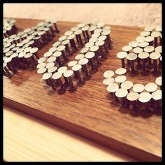 house numbers, monogram, inspirational word, or clip art shape using nails and old board